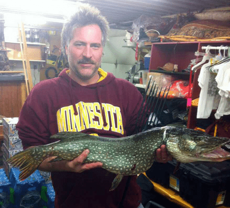 Eleven and a half pound northern pike caught in a Little Winnie Resort Darkhouse.