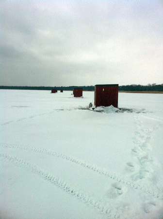 Darkhouse spearing minnesota darkhouse spearing rentals for Ice fishing rentals mn